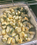 Using a foil pan allows you to easily smoke chopped vegetables
