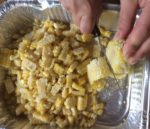 Triming the kernels off the corn on the cob
