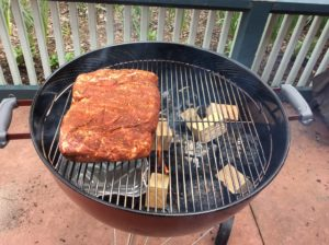 Our Boston Butt on the Weber® kettle Grill with double filet wood chunks