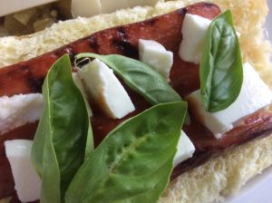 our Italiano Dog has fresh moxxarella, fresh basil and marina sauces.