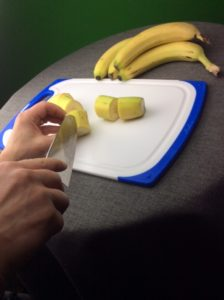 Cutting and removing the peel to prep the bananas