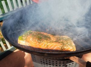 Salmon on a two zone grill absorbing all the great smoke flavor