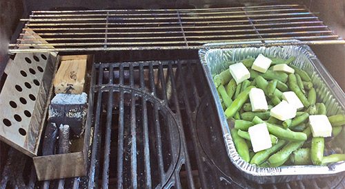 The SmokinLicious® culinary crew's two-zone cooking method set up to smoke Fava Beans on the Gas grill with Wood chunks!