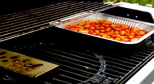 Our Roasted Tomatoes on the gas grill with smoker box containing two Double Filet wood chunks!