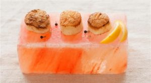 Seafood resting on top of salt block