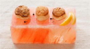 Seafood resting on top of salt block