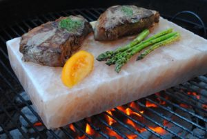 salt block on grill with food on top
