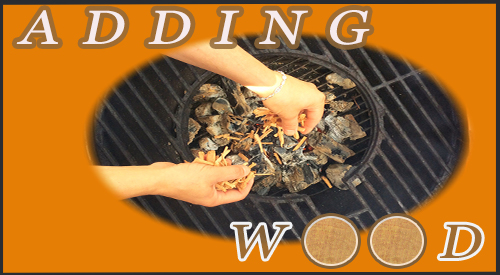 Showing the technique on how to add wood chips over charcoal with wood to enhance the flavor of any meat, fish, or vegetable being cooked